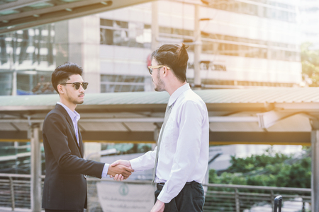 Photo for Business handshake concept. shaking hand of two businessman negotiation closing a deal city background - Royalty Free Image