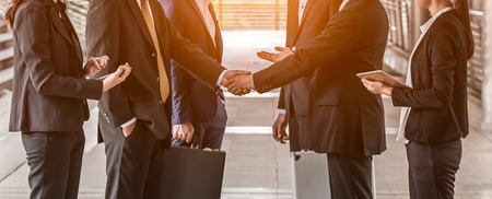 Photo pour business people  handshake concept. shaking hand of group of businessman negotiation closing a deal city background - image libre de droit