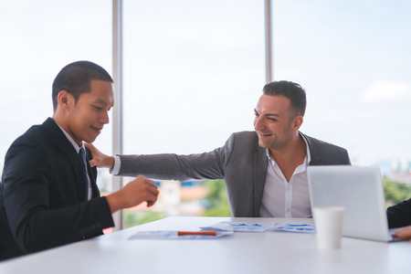 Photo for Businessman was given appreciate and compliments from his boss who successfully worked. - Royalty Free Image
