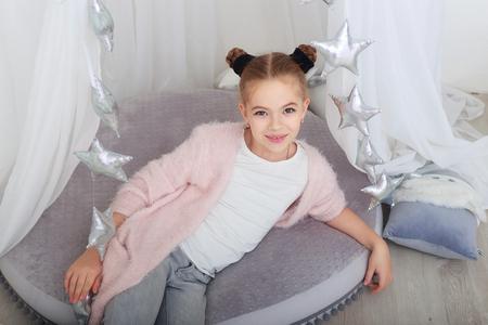Foto de portrait of smiling little girl in white christmas decorations - Imagen libre de derechos