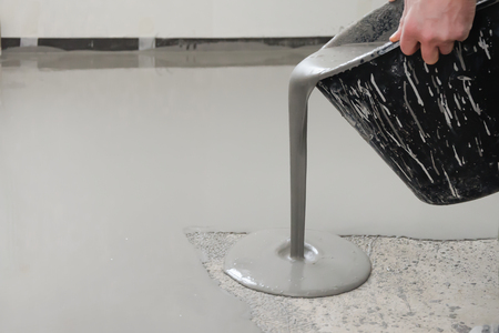 Photo for Self-leveling epoxy. Leveling with a mixture of cement floors. - Royalty Free Image
