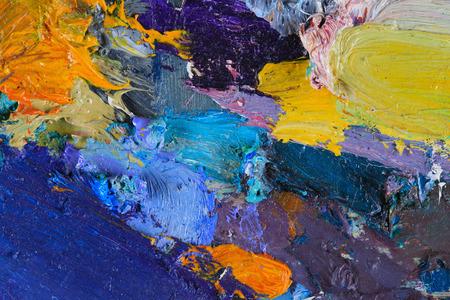 Foto de macro artist's palette, texture mixed oil paints in different colors and saturation studio - Imagen libre de derechos