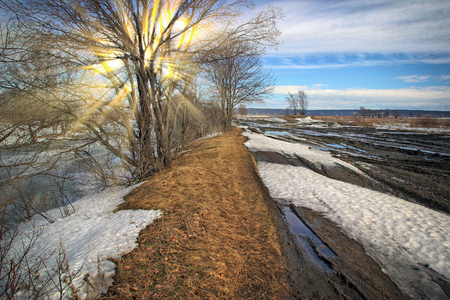 Photo pour Scenic landscape in early spring in the field and blurred dirt road on a sunny day - image libre de droit