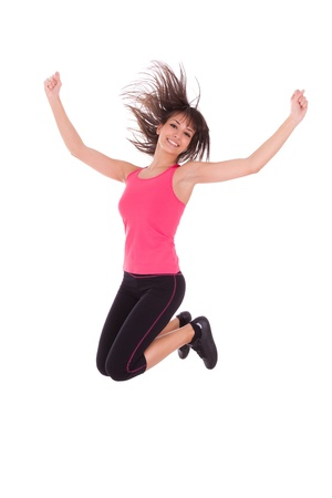 Weight loss fitness woman jumping of joy,isolated on white background