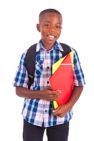 Foto de African American school boy, holding folders, isolated on white background - Black people - Imagen libre de derechos