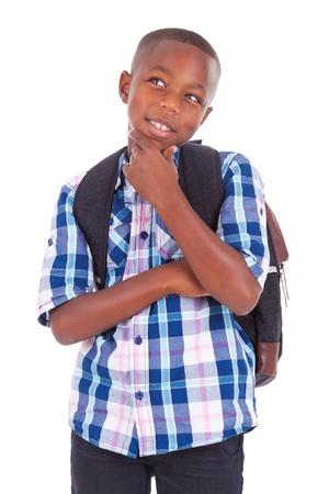 Foto de African American school boy looking up, isolated on white background - Black people - Imagen libre de derechos