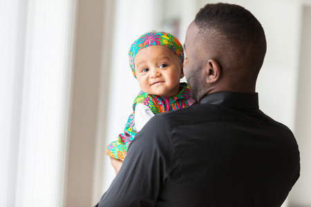 Photo for Young african american father holding with her baby girl - Royalty Free Image