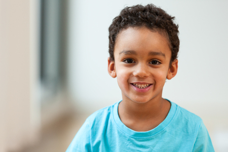 Photo pour Portrait of a cute little African American boy smiling - image libre de droit