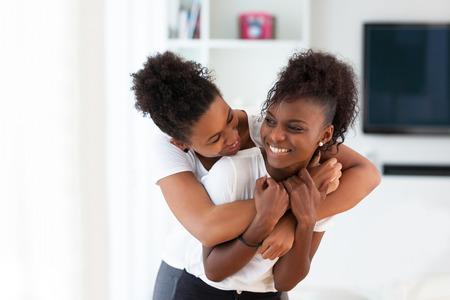 Foto de African American best friends portrait hugging - Black people - Imagen libre de derechos