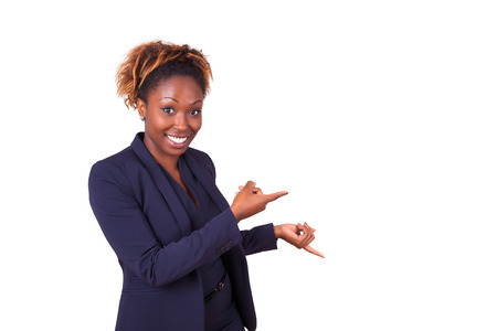 Photo pour African American business woman pointing something, isolated on white background - image libre de droit