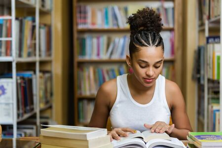 Photo for Black african american young girl student studying at the school university library - Royalty Free Image