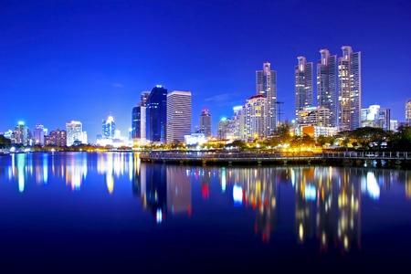 Foto de Bangkok city downtown at night with reflection of skyline, Bangkok,Thailand - Imagen libre de derechos