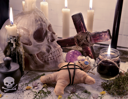 Photo for Voodoo still life with skull, doll and burning candles. Halloween concept. Mystic background with occult and magic objects on witch table - Royalty Free Image