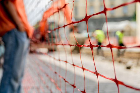 Photo for orange construction site net around construction site, shallow depth of field - Royalty Free Image