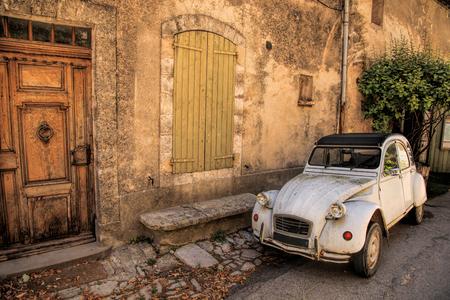 Foto de Classic French car on a street in the Provence, France - Imagen libre de derechos