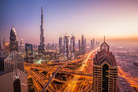 Photo pour Night cityscape of Dubai with modern futuristic architecture , United Arab Emirates - image libre de droit