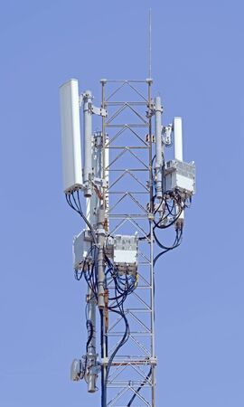 Foto de Tower with aerials of cellular on a background mountains and blue sky - Imagen libre de derechos