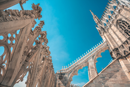 Photo for view of Gothic architecture and art on the roof of Milan Cathedral (Duomo di Milano), Italy. - Royalty Free Image