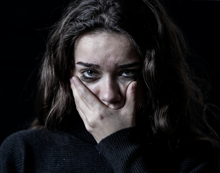 Photo for Dramatic closeup portrait of young scared, depressed girl crying alone, feeling hopeless suffering from harassment or domestic violence. Stop child abuse and neglect. Social campaign concept. - Royalty Free Image