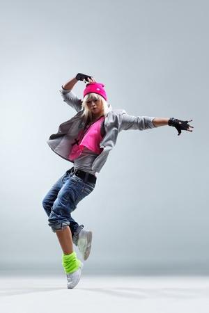 Foto de modern style dancer jumping on studio background - Imagen libre de derechos