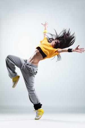 Foto de modern style dancer posing on studio background - Imagen libre de derechos