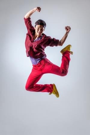 Foto de young beautiful dancer posing on a studio background - Imagen libre de derechos