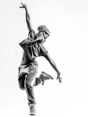 Foto de Young beautiful dancer jumping in studio - Imagen libre de derechos