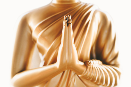 Foto de Close up of the hands of statue Buddha - Imagen libre de derechos