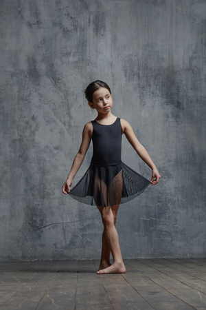 Photo for Ballerina girl posing in dance studio - Royalty Free Image