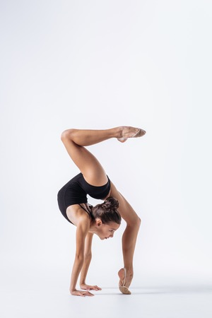 Photo for Young gymnast girl stretching and training - Royalty Free Image