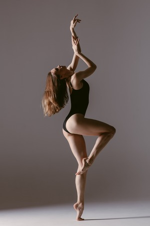 Photo for Young gymnast woman stretching and training - Royalty Free Image