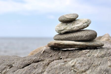 Photo pour pebbles piled on rocks  on the seafront - image libre de droit