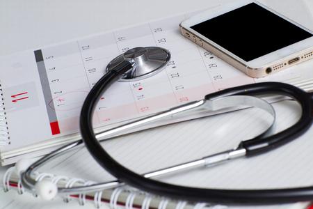 Foto de Regular medical examination concept, stethoscope on calendar - Imagen libre de derechos