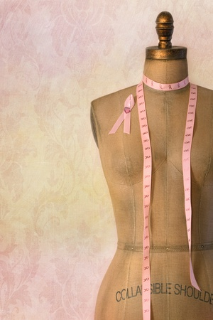 Photo pour Pink breast cancer ribbon on mannequin  dress form with vintage background - image libre de droit