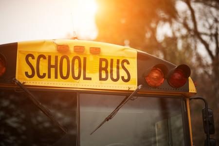 Foto de Front closeup view of yellow school bus windshield sign at sunset - Imagen libre de derechos