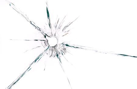 Foto de bullet hole in glass close up on white background - Imagen libre de derechos