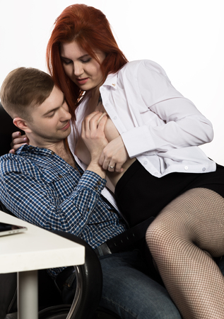 Photo pour young sexy secretary is sexually harassing to her boss. love affair at work - image libre de droit