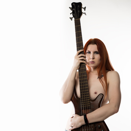 Photo for nude rock woman holding electric guitar on a white background. free space for text - Royalty Free Image
