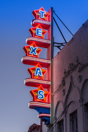 Photo for Neon sign in the shape of stars that spell Texas - Royalty Free Image