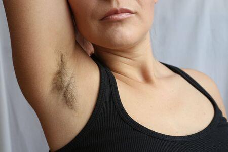 Foto de Female hairy armpit, unshaved underarms new fashion trend concept. - Imagen libre de derechos