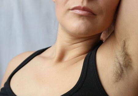 Foto de Woman with armpit hair, hair growth, depilation or new natural trend unshaved hair concept. - Imagen libre de derechos