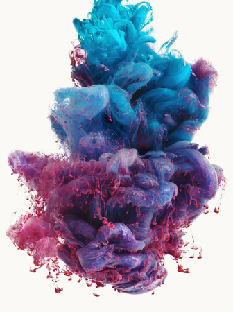 Photo pour Color drop falling in water creating a Color spread. Isolated on white background. Colorful ink drop. Movement of paint in water. Water coloring. - image libre de droit