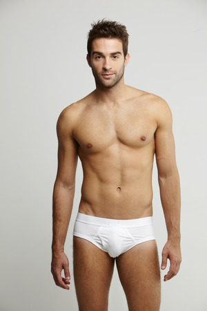 Photo for Portrait of mid adult man in briefs, studio shot - Royalty Free Image
