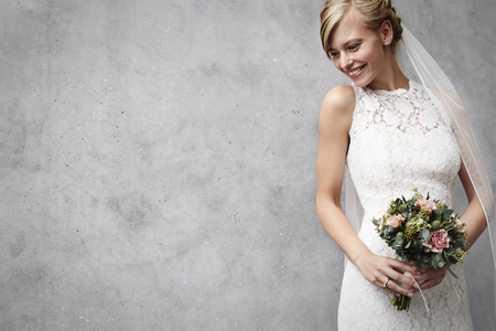 Photo for Beautiful wedding babe in dress with flowers - Royalty Free Image