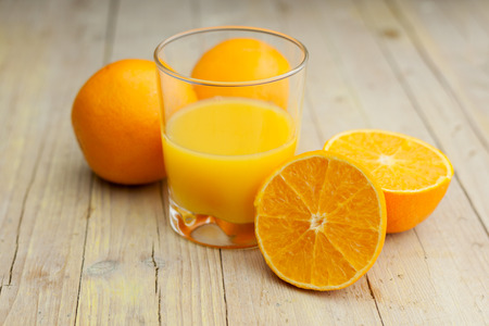 Photo for Composition of orange cut glass with juice - Royalty Free Image