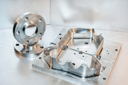 Photo pour Metal mold blank and steel flanges  Milling and drilling industry  CNC technology  - image libre de droit