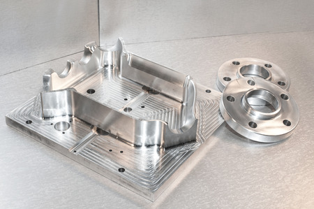 Photo pour Metal mold blank and steel flanges  Milling and drilling industry  CNC technology  Mechanical engineering - image libre de droit