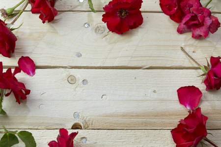 Photo for Frame of red roses on wooden background - Royalty Free Image