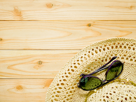 Photo for Sunglasses and beach hat on wooden background with copy space. Women's beachwear accessories for protecting skin and eyes from the sun. Summer holiday concept. - Royalty Free Image