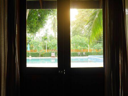 Foto de View of swimming pool from room window - Imagen libre de derechos